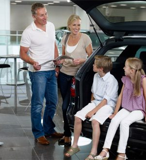 Family at Car Dealership